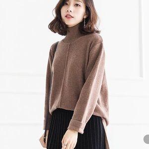 Brown turtle neck high low hem sweater